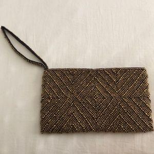 Handbags - Gold beaded wristlet clutch